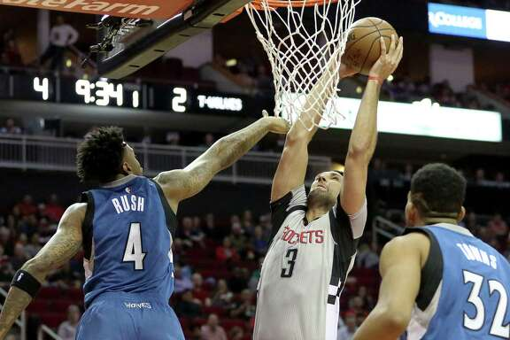 Houston Rockets forward Ryan Anderson (3) dunks the ball into the basket while Minnesota Timberwolves guard Brandon Rush (4) is trying to block him during the first quarter of the game at Toyota Center Saturday, Feb. 25, 2017, in Houston.