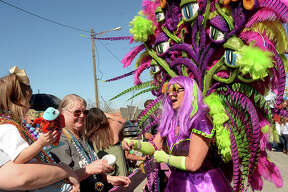 Krewe royalty, including Marianne Petry, march down Procter Street, passing out beads and trinkets to the crowd, during the Mardi Gras of Southeast Texas festivities Saturday afternoon in Port Arthur. Photo taken Saturday, February 25, 2017 Kim Brent/The Enterprise