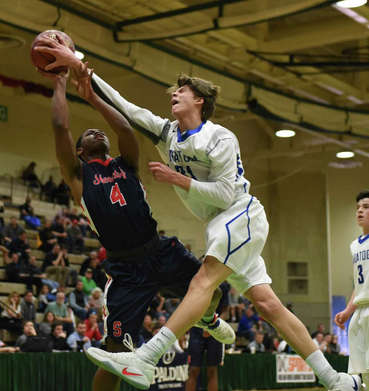 Schenectady's Cameron Coles, left, is blocked by Saratoga's Will Fox, right, during the Class Class AA boys' basketball quarterfinal on Saturday, Feb. 25, 2017, at Hudson Valley Community College in Troy, N.Y. (Will Waldron/Times Union)