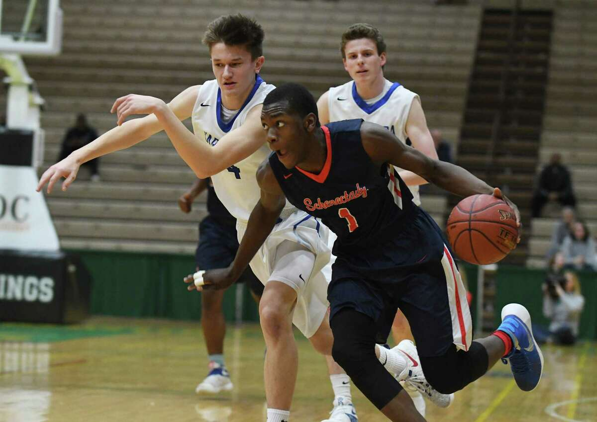 Schenectady's Tyrone Jenkins drives to the basket while being guarded by Saratoga'?'s Brian Hart, left, during the Class Class AA boys'?' basketball quarterfinal on Saturday, Feb. 25, 2017, at Hudson Valley Community College in Troy, N.Y. (Will Waldron/Times Union)