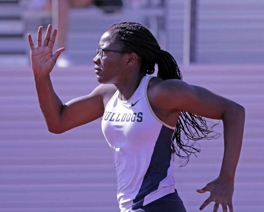 Alexander's Cynthia Emeremnu picked up gold medals in the 100- and 200-meter dashes to go alongside a first in the long jump at the Medina Valley Relays. Photo: Clara Sandoval / Laredo Morning Times