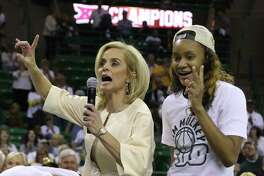 Baylor head women's coach Kim Mulkey celebrates her 500th career win with forward Nina Davis, right, following an NCAA college basketball game against Texas Tech, Saturday, Feb. 25, 2017, in Waco, Texas. Baylor won 86-48. (AP Photo/Rod Aydelotte)