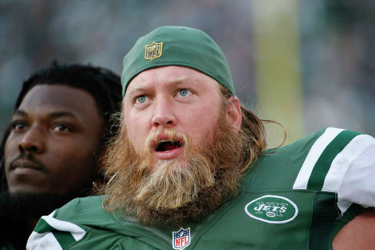 FILE - In this Dec. 13, 2015, file photo, New York Jets center Nick Mangold, right, and Chris Ivory, left, look at the scoreboard during the first half of an NFL football game against the Tennessee Titans in East Rutherford, N.J. Mangold has a sprained right ankle that is likely to keep him out Sunday, Nov. 13, 2016, against the Los Angeles Rams. (AP Photo/Julio Cortez, File) ORG XMIT: NY908