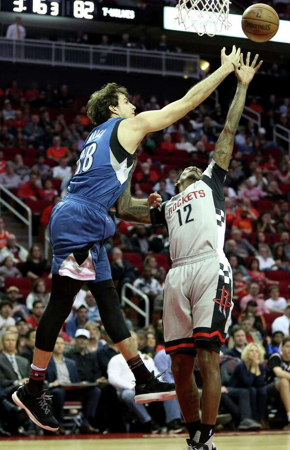 Minnesota Timberwolves forward Nemanja Bjelica (88) and Houston Rockets guard Lou Williams (12) fights over a rebound during the second half of the game at Toyota Center Saturday, Feb. 25, 2017, in Houston. Photo: Yi-Chin Lee, Houston Chronicle / © 2017  Houston Chronicle