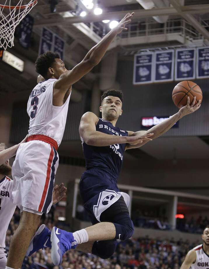 BYU guard Elijah Bryant shoots over Gonzaga for ward Johnathan Williams during the first half. Photo: Young Kwak, Associated Press