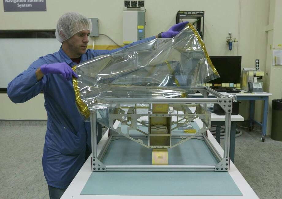 Southwest Research Institute's Nicholas Alexander covers the frame of a weather satellite. SwRI is one of the San Antonio's leading employers of STEM workers. The area ranks No. 6 in the country in STEM professional pay when combined with the rate of STEM pay increases. Photo: Billy Calzada /San Antonio Express-News / San Antonio Express-News