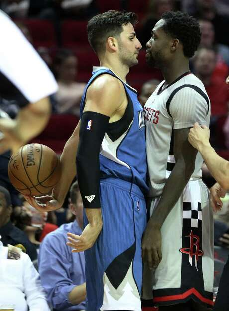 Minnesota's Ricky Rubio, left, and the Rockets' Pat Beverley weren't seeing eye to eye during this third-quarter standoff. Beverley earned a technical. Photo: Yi-Chin Lee, Staff / © 2017  Houston Chronicle