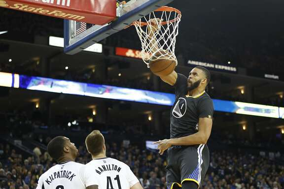 JaVale McGee (1) of the Golden State Warriors makes a dunk during the third quarter of their NBA basketball game at Oracle Arena in Oakland, Calif. on Saturday, Feb. 25, 2017. The Warriors defeated the Nets 112-95.