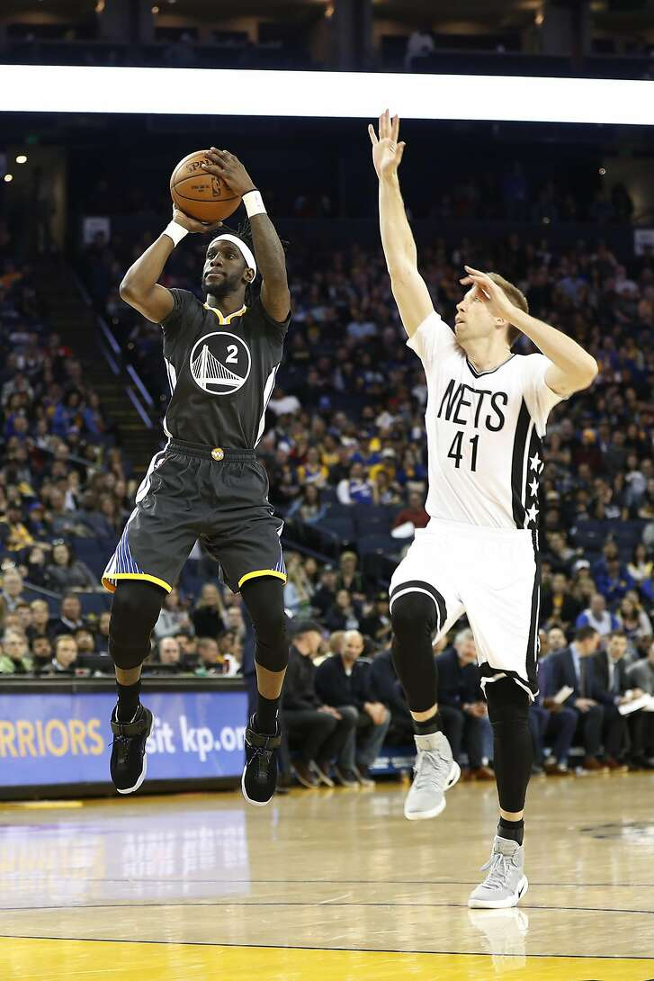 Briante Weber (2) of the Golden State Warriors shoots the ball as Justin Hamilton (41) of the Brooklyn Nets defends during the fourth quarter of their NBA basketball game at Oracle Arena in Oakland, Calif. on Saturday, Feb. 25, 2017. The Warriors defeated the Nets 112-95.