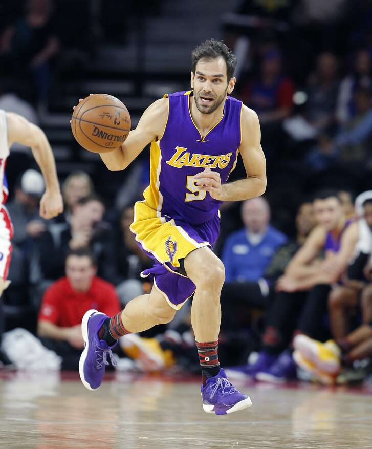 Los Angeles Lakers guard Jose Calderon brings the ball up court during the second half of an NBA basketball game against the Detroit Pistons, Wednesday, Feb. 8, 2017, in Auburn Hills, Mich. (AP Photo/Carlos Osorio)