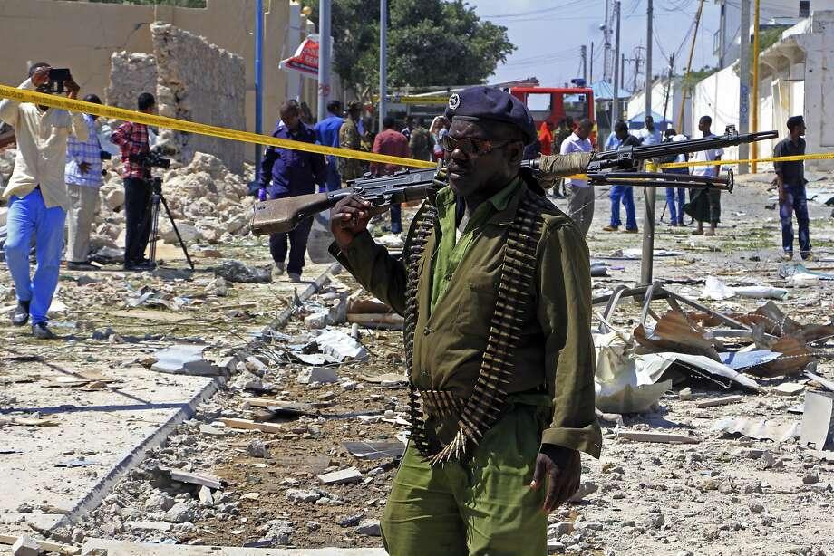 A Somali soldier patrols the area of a suicide car bomb attack last month in Mogadishu, Somalia. Photo: Farah Abdi Warsameh, Associated Press