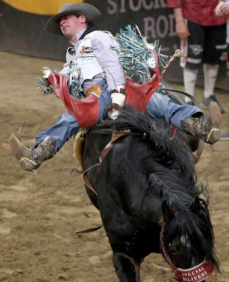 Tim O'Connell, from Zwingle, IA, competes in the finals of the bareback riding event during the San Antonio Stock Show & Rodeo held Saturday Feb. 25, 2017 at the AT&T Center. O'Connell scored a 91.00 on his ride and placed second in the event. Tyler Nelson, from Victor, ID, scored a 91.50 on his ride and won the event. Photo: Edward A. Ornelas, Staff / San Antonio Express-News / © 2017 San Antonio Express-News
