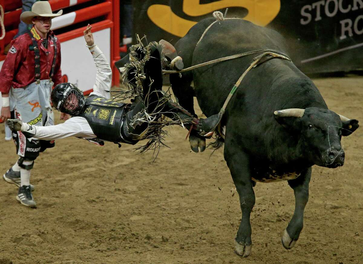 Sage Steele Kimzey, from Strong City, Okla., is thrown off his bull in finals of the bull riding event during the San Antonio Stock Show & Rodeo in 2017 at the AT&T Center. Roscoe Jarboe, from New Plymouth, Idaho, (not pictured) scored a 91.00 on his ride and won the event.
