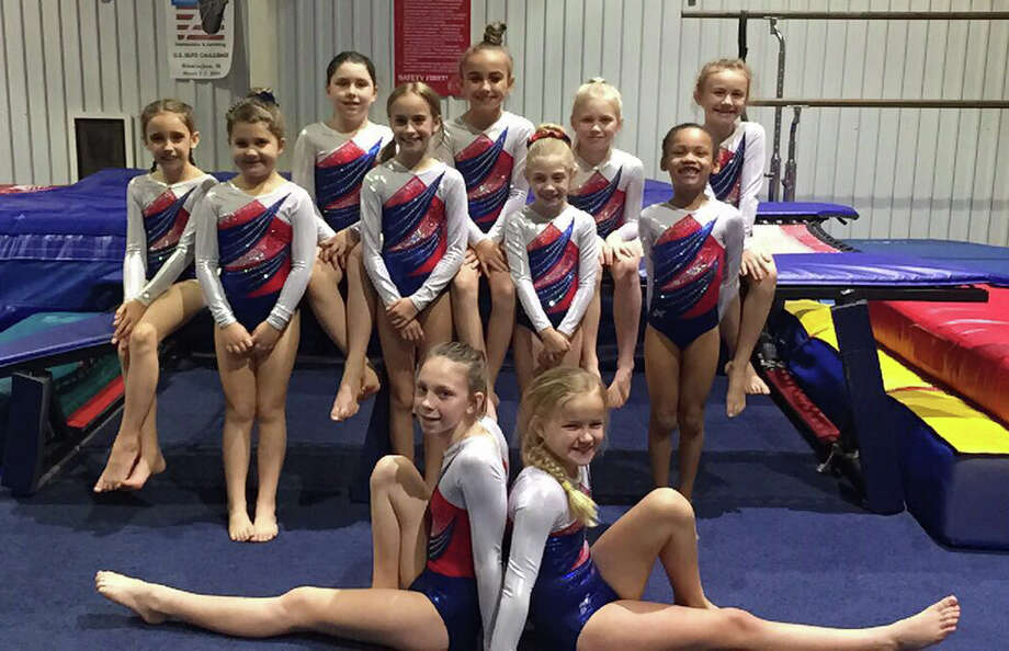 Eleven girls make up the 2016-2017 team of gymnasts from Tarkington Athletic Center. Photo: Submitted