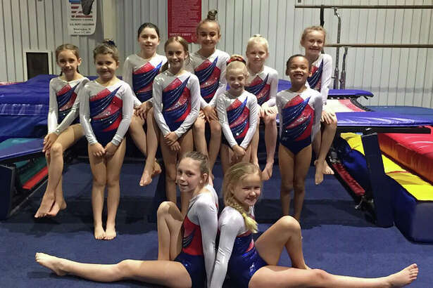 Eleven girls make up the 2016-2017 team of gymnasts from Tarkington Athletic Center.