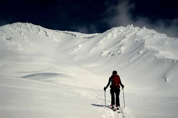 On cross-country skis, Jenn Carr ventures on the moraines at the foot of Avalanche Gulch at Mount Shasta in Northern California