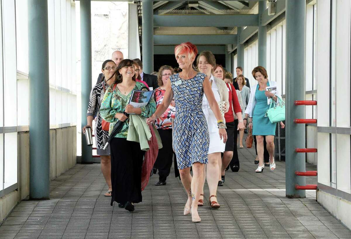 Deb Goedeke, center, of Albany Convention Center Authority & Visitors Bureau leads community and business leaders during a tour of Albany Capital Center Site from the Times Union Center walkway Tuesday, June 9, 2015, in Albany, NY. (John Carl D'Annibale / Times Union)