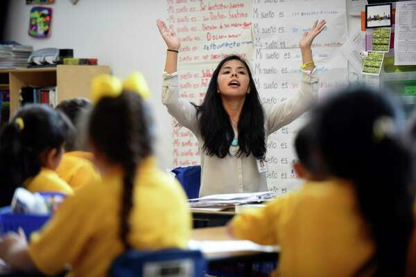 Maria Rocha, who teaches at KIPP Esperanza Dual Language Academy, works with students on Wednesday, Jan. 11, 2017. Rocha is an immigrant and has deferred action status.