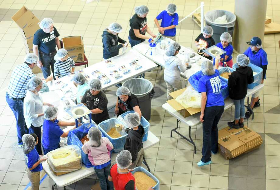 Volunteers prepare packs of food during the Feed My Starving Child MobilePack program Saturday, at the TAMIU Student Center. Photo: Danny Zaragoza /Laredo Morning Times / Laredo Morning Times