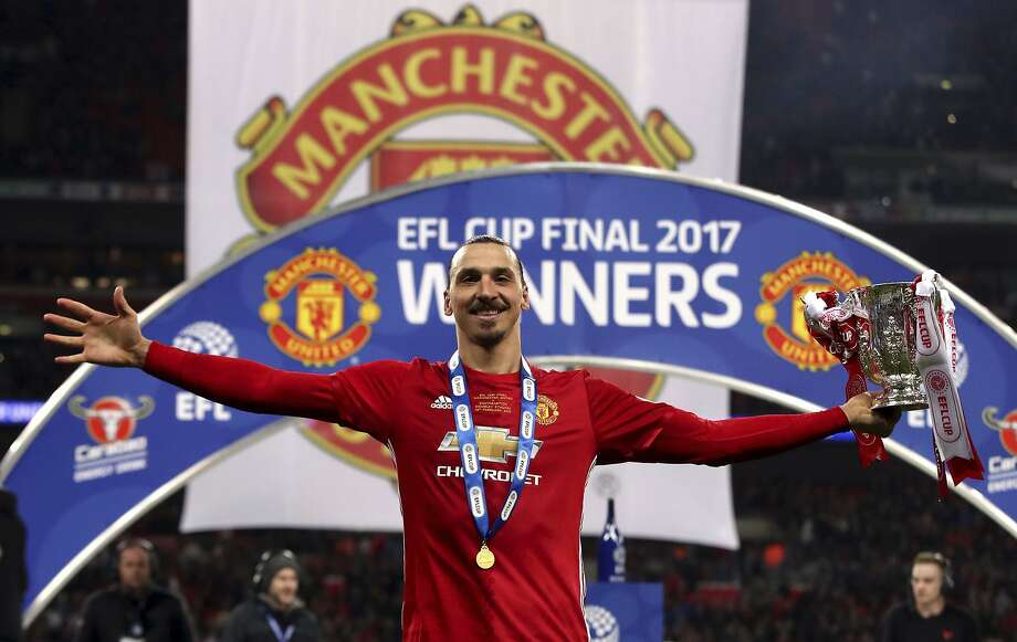 Manchester United's Zlatan Ibrahimovic, who scored twice, celebrates with the League Cup. Photo: Nick Potts, Associated Press