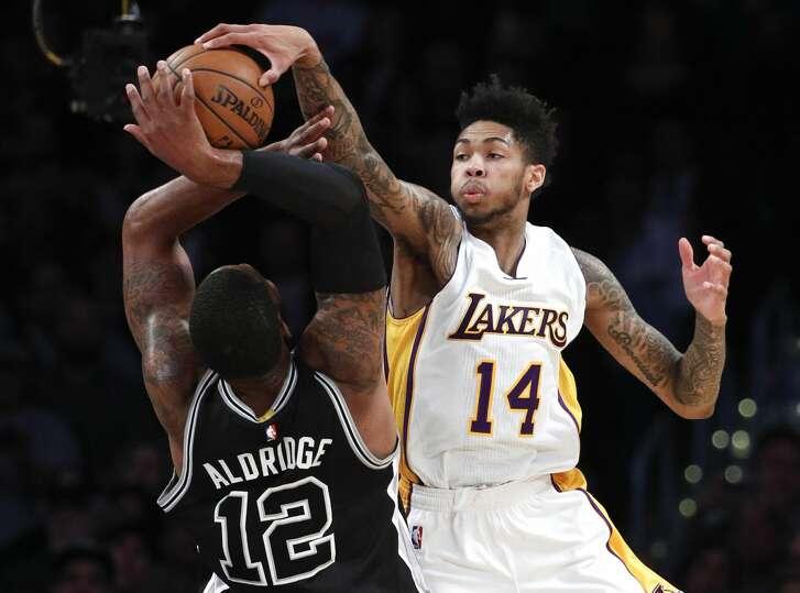 San Antonio Spurs' LaMarcus Aldridge, left, has his shot blocked by Los Angeles Lakers' Brandon Ingram during the first half of an NBA basketball game, Sunday, Feb. 26, 2017, in Los Angeles. (AP Photo/Jae C. Hong)