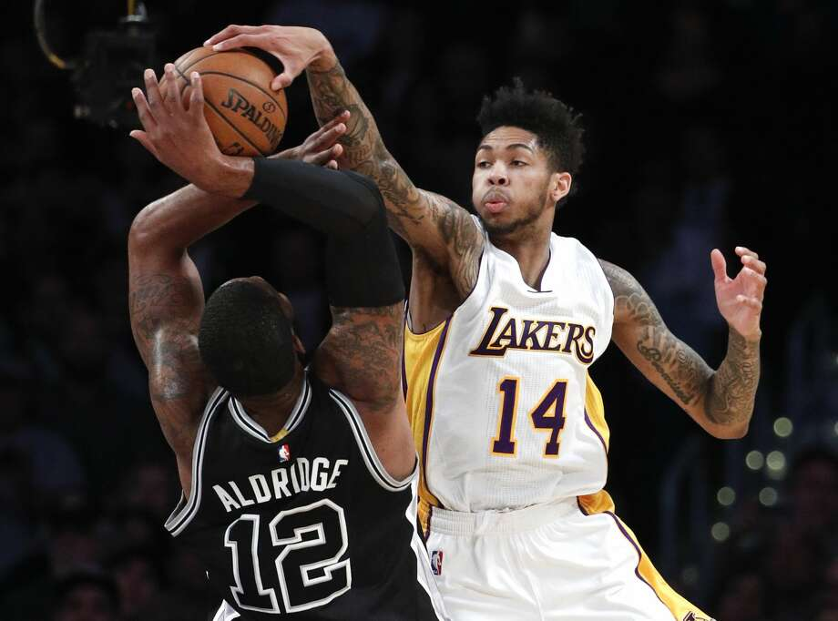 San Antonio Spurs' LaMarcus Aldridge, left, has his shot blocked by Los Angeles Lakers' Brandon Ingram during the first half of an NBA basketball game, Sunday, Feb. 26, 2017, in Los Angeles. (AP Photo/Jae C. Hong) Photo: Jae C. Hong/Associated Press