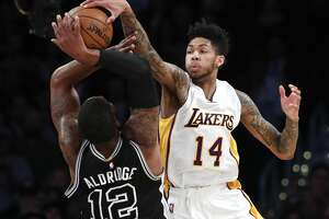 San Antonio Spurs' LaMarcus Aldridge, left, has his shot blocked by Los Angeles Lakers' Brandon Ingram during the first half of an NBA basketball game, Sunday, Feb. 26, 2017, in Los Angeles. (AP Photo/Jae C. Hong)