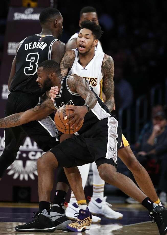 San Antonio Spurs' Jonathon Simmons is defended by Los Angeles Lakers' Brandon Ingram, top, during the first half of an NBA basketball game, Sunday, Feb. 26, 2017, in Los Angeles. (AP Photo/Jae C. Hong) Photo: Jae C. Hong/Associated Press