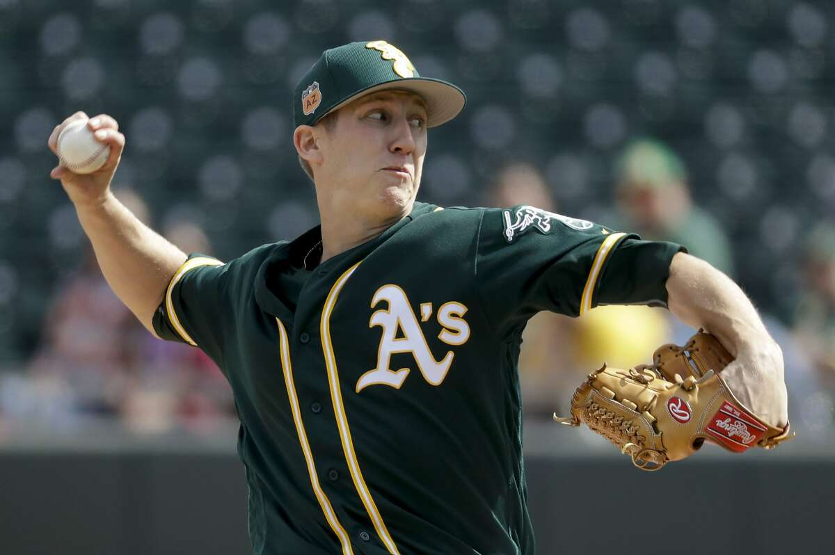 Oakland Athletics starting pitcher Daniel Gossett throws against the Los Angeles Angels during the first inning of a spring baseball game in Mesa, Ariz., Sunday, Feb. 26, 2017. (AP Photo/Chris Carlson)
