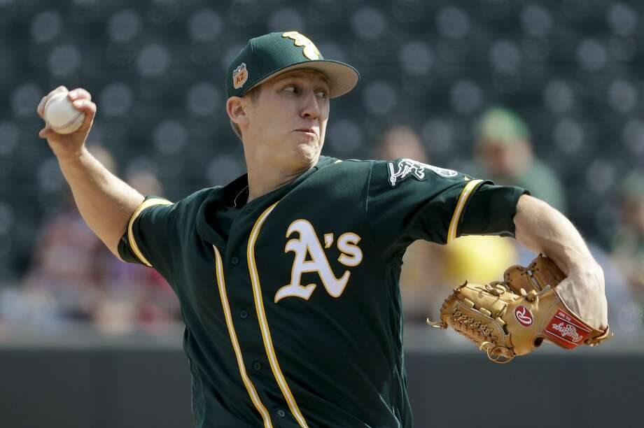 Oakland Athletics starting pitcher Daniel Gossett throws against the Los Angeles Angels during the first inning of a spring baseball game in Mesa, Ariz., Sunday, Feb. 26, 2017. (AP Photo/Chris Carlson) Photo: Chris Carlson, Associated Press