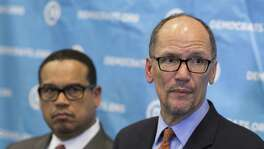 Newly elected Democratic National Committee Chairman Tom Perez, right, and Rep. Keith Ellison, D-Minn., who was named deputy chairman, listen to a question from the media during a press conference at the DNC winter meeting in Atlanta, Saturday, Feb. 25, 2017. (AP Photo/Branden Camp)