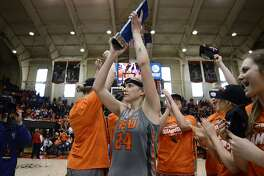 Oregon State guard Sydney Wiese (24) holds up the Pac-12 regular-season trophy after their win against the California in an NCAA college basketball game Sunday, Feb. 26, 2017. Oregon State won the game 71-56 to claim the Pac-12 championship title for a third-straight regular season. (Anibal Ortiz/The Corvallis Gazette-Times via AP)
