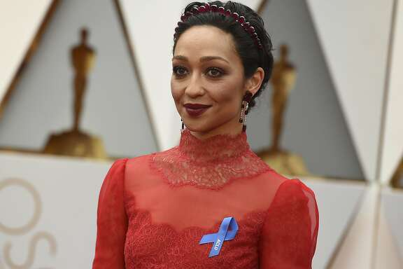 Ruth Negga wears an ACLU ribbon as she arrives at the Oscars on Sunday, Feb. 26, 2017, at the Dolby Theatre in Los Angeles. (Photo by Richard Shotwell/Invision/AP)