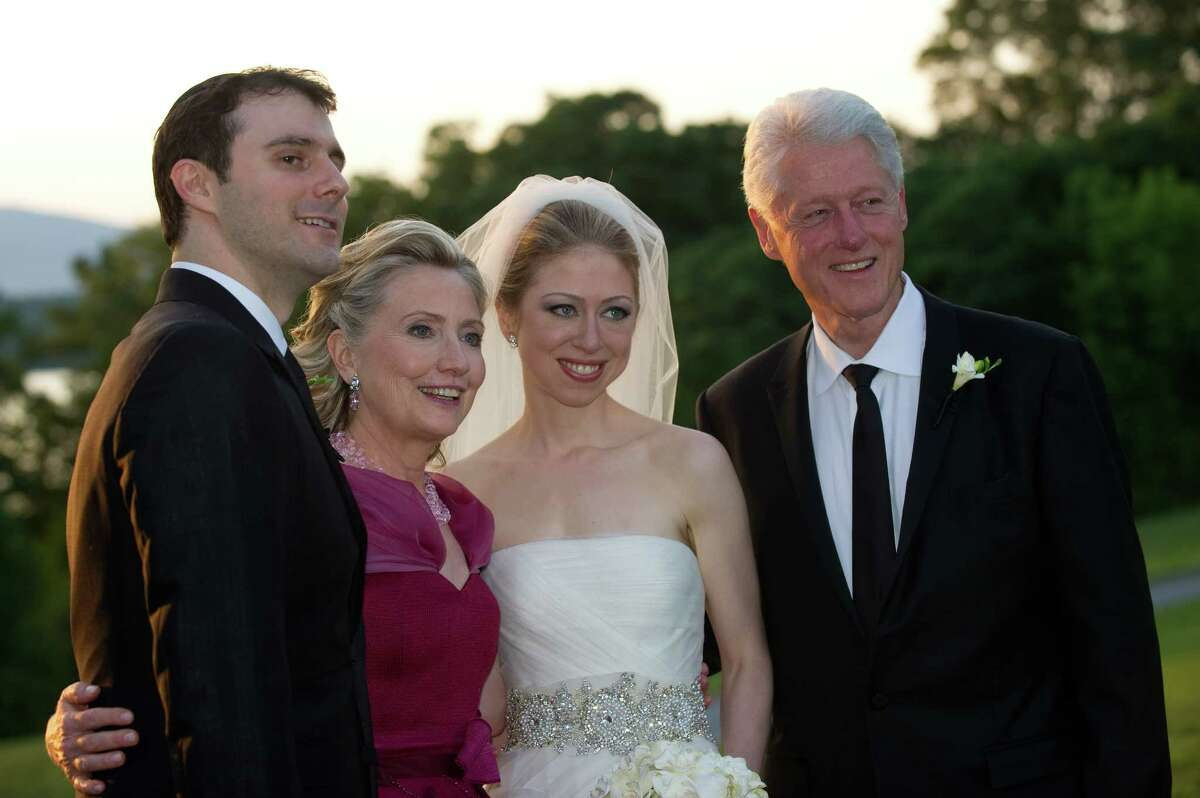 FILE - SEPTEMBER 26: Chelsea Clinton and husband Marc Mezvinsky welcomed daughter, Charlotte Clinton Mezvinsky. RHINEBECK, NY - JULY 31: In this handout image provided by Barbara Kinney, (L-R) Marc Mezvinsky, U.S. Secretary of State Hillary Clinton, Chelsea Clinton and former U.S. President Bill Clinton pose during the wedding of Chelsea Clinton and Marc Mezvinsky at the Astor Courts Estate on July 31, 2010 in Rhinebeck, New York. Chelsea Clinton, the daughter of former U.S. President Bill Clinton and Secretary of State Hillary Clinton, married Marc Mezvinsky today in an interfaith ceremony at the estate built by John Jacob Astor on the Hudson River about two hours north of New York City. (Photo by Barbara Kinney via Getty Images) ORG XMIT: 503816393