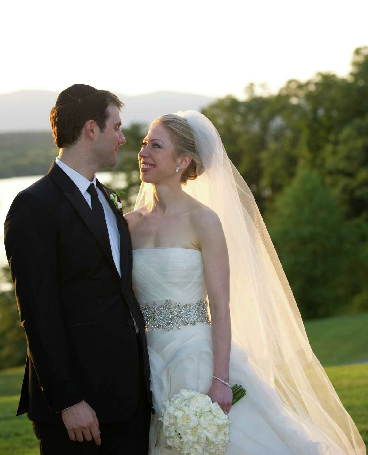 FILE - SEPTEMBER 26: Chelsea Clinton and husband Marc Mezvinsky welcomed daughter, Charlotte Clinton Mezvinsky. RHINEBECK, NY - JULY 31: In this handout image provided by Barbara Kinney, Marc Mezvinsky (L) and Chelsea Clinton pose during their wedding at the Astor Courts Estate on July 31, 2010 in Rhinebeck, New York. Chelsea Clinton, the daughter of former U.S. President Bill Clinton and Secretary of State Hillary Clinton, married Marc Mezvinsky today in an interfaith ceremony at the estate built by John Jacob Astor on the Hudson River about two hours north of New York City. (Photo by Barbara Kinney via Getty Images) ORG XMIT: 503816393