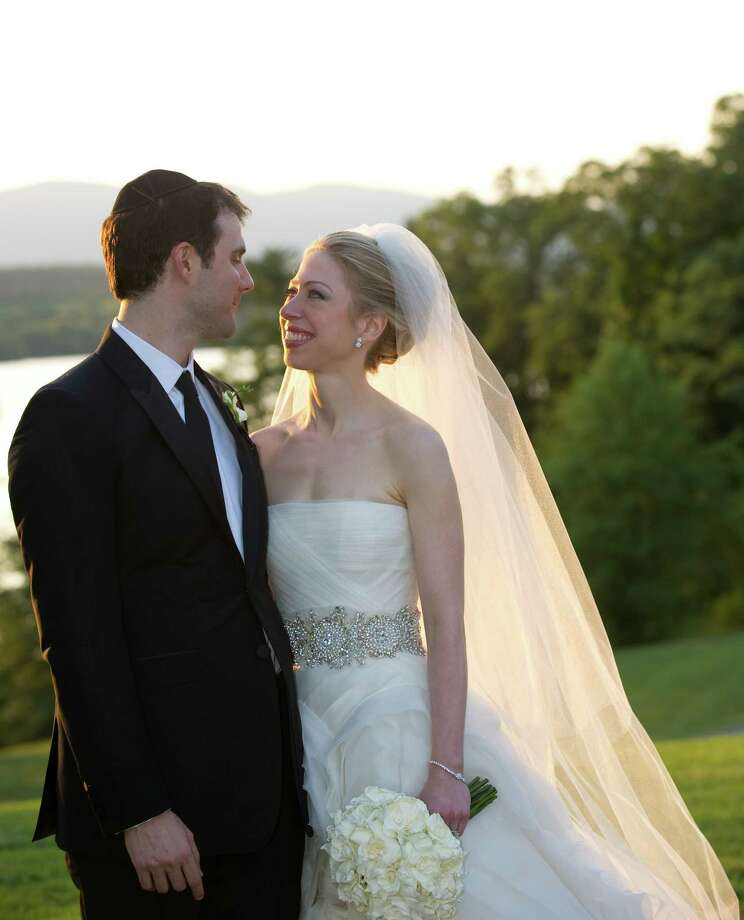 FILE - SEPTEMBER 26: Chelsea Clinton and husband Marc Mezvinsky welcomed daughter, Charlotte Clinton Mezvinsky. RHINEBECK, NY - JULY 31:  In this handout image provided by Barbara Kinney, Marc Mezvinsky (L) and Chelsea Clinton pose during their wedding at the Astor Courts Estate on July 31, 2010 in Rhinebeck, New York. Chelsea Clinton, the daughter of former U.S. President Bill Clinton and Secretary of State Hillary Clinton, married Marc Mezvinsky today in an interfaith ceremony at the estate built by John Jacob Astor on the Hudson River about two hours north of New York City.  (Photo by Barbara Kinney via Getty Images) ORG XMIT: 503816393 Photo: Handout / 2010 Barbara Kinney