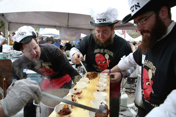 Aishel House members Dannos Cablammos, left, Peretz Lazaroff and Rabbi Shmuli Slonim scoop chili into cups for their guests at the Seventh Annual Houston Kosher Chili Cookoff at Evelyn Rubenstein Jewish Community Center Sunday, Feb. 26, 2017, in Houston.