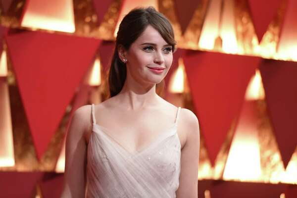 Felicity Jones arrives at the Oscars on Sunday, Feb. 26, 2017, at the Dolby Theatre in Los Angeles. (Photo by Richard Shotwell/Invision/AP)
