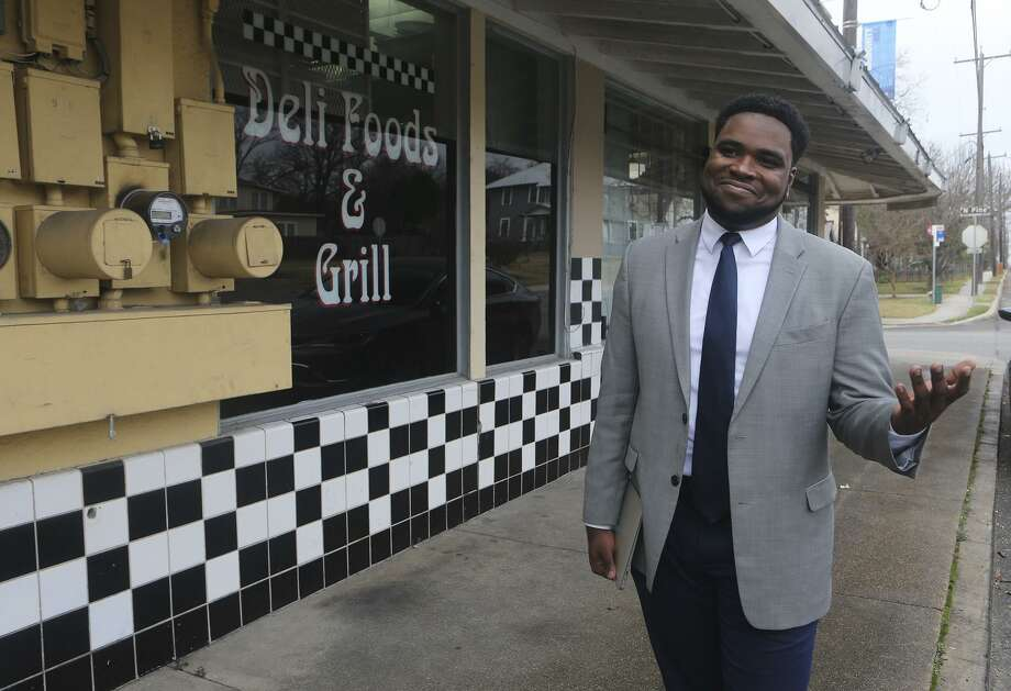 Akeem Brown, Director of Operations for Sage (San Antonio for Growth on the East Side), is pushing for development and progress on San Antonio's East Side. Brown is brokering deals to attract business and commerce on the East Side, and helping small business owners such as Sergio Calderon who owns the Panchos and Gringos Deli (background) on Nolan Street. Photo: John Davenport, Staff / San Antonio Express-News / ©San Antonio Express-News/John Davenport