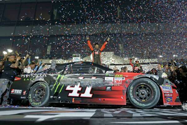 Kurt Busch celebrates in Victory Lane after winning the NASCAR Daytona 500 auto race at Daytona International Speedway in Daytona Beach, Fla., Sunday, Feb. 26, 2017. (AP Photo/Chuck Burton)