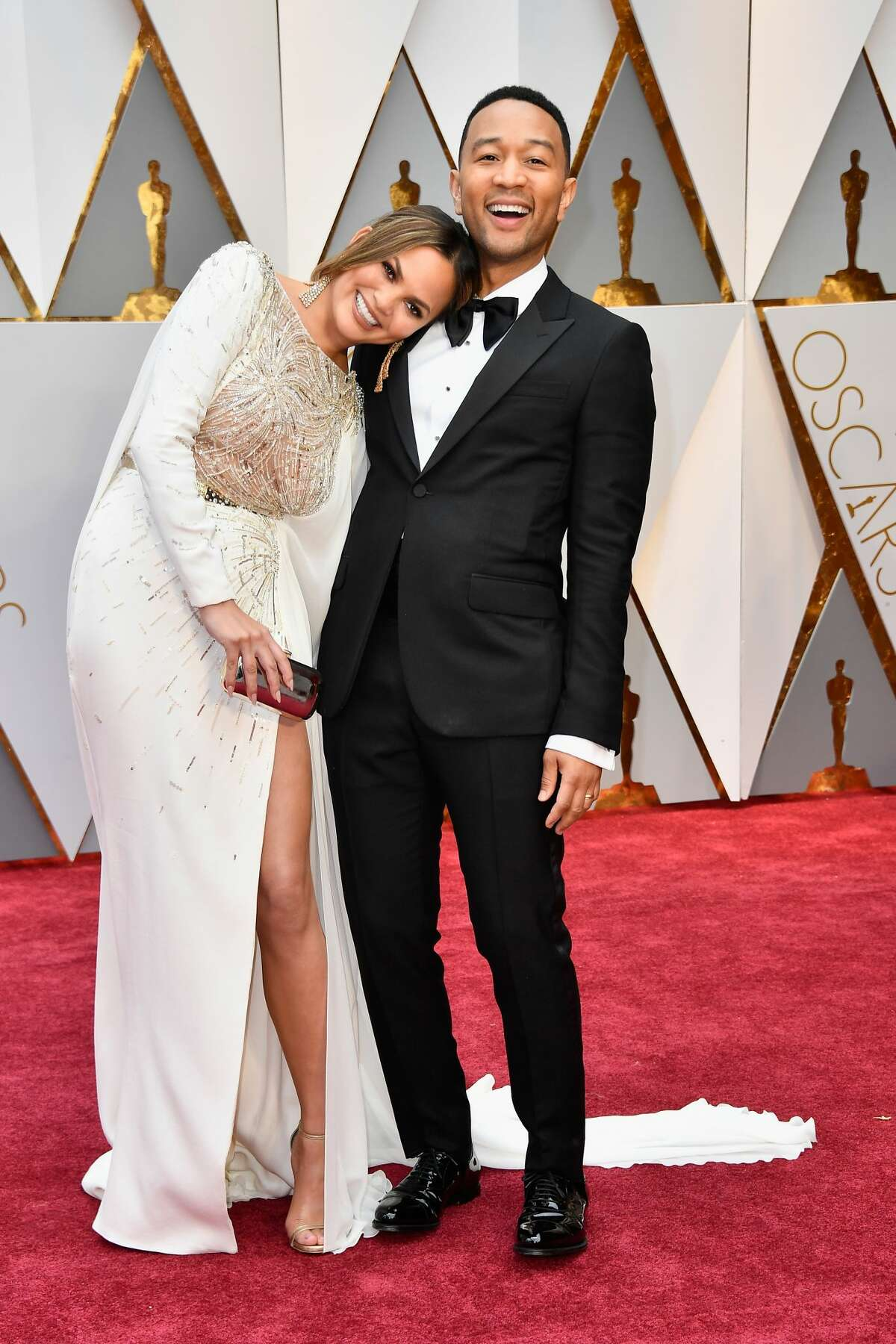 Model Chrissy Teigen (L) and singer John Legend attend the 89th Annual Academy Awards on February 26, 2017.
