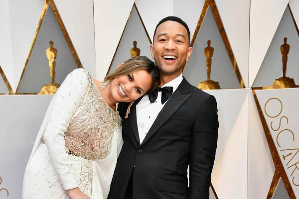 HOLLYWOOD, CA - FEBRUARY 26:  Model Chrissy Teigen (L) and singer John Legend attend the 89th Annual Academy Awards at Hollywood & Highland Center on February 26, 2017 in Hollywood, California.  (Photo by Frazer Harrison/Getty Images)
