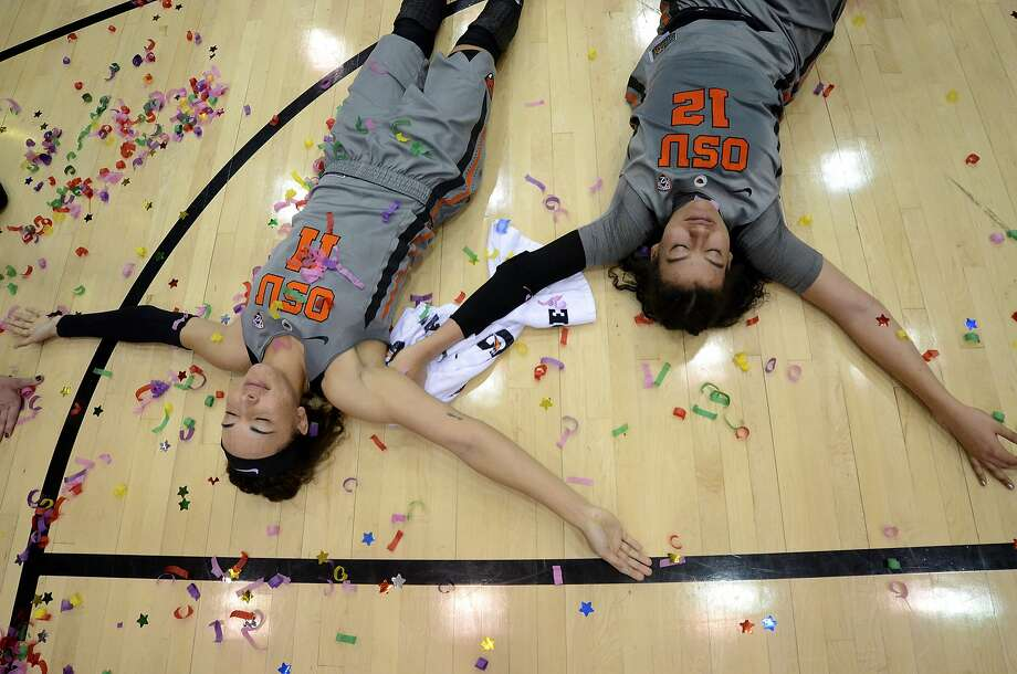 Oregon State's Gabriella Hanson (11) and Kolbie Orum (12) play on the court after their NCAA college basketball game win over California on Sunday, Feb. 26, 2017. Oregon State won the game 71-56 to claim the Pac-12 championship title for a third-straight regular season.  (Anibal Ortiz/The Corvallis Gazette-Times via AP) Photo: Anibal Ortiz, Associated Press