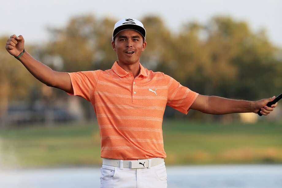Rickie Fowler gets the party started after sinking his clinching putt on the 18th green to win the Honda Classic. Photo: Sam Greenwood, Getty Images