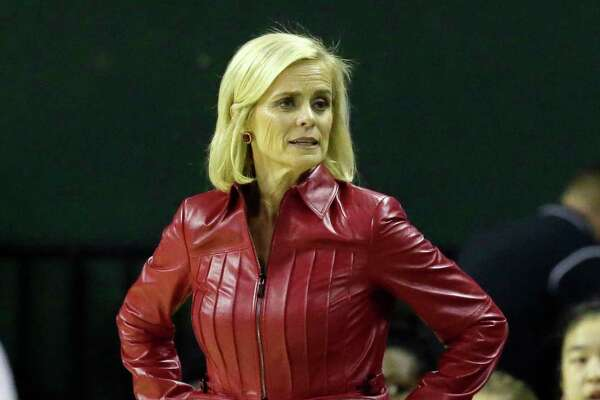 Baylor head coach Kim Mulkey stands on the side lines during the first half of an NCAA college basketball game against Texas in Waco, Texas, Monday, Feb. 6, 2017. (AP Photo/LM Otero)