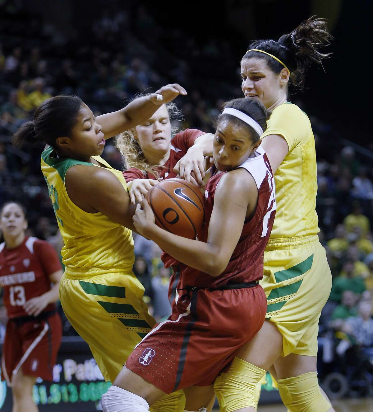 Oregon's Oti Gildon and Jacinta Vandenberg battle with Stanford's Erica McCall and Brittany McPhee for control of the ball during an NCAA college basketball game at Matthew Knight Arena in Eugene, Ore., Sunday Feb. 26, 2017. Stanford won the game 65-59. (Andy Nelson/The Register-Guard via AP)