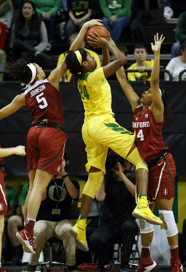 Oregon's Ruthy Hebard has her shot blocked by Stanford's Kaylee Johnson as Stanford's Erica McCall helps defend on the play during the first half of an NCAA college basketball game in Eugene, Ore., Sunday, Feb. 26, 2016. Eighth-ranked Stanford won game 65-59. (Andy Nelson/The Register-Guard via AP) Photo: Andy Nelson, Associated Press