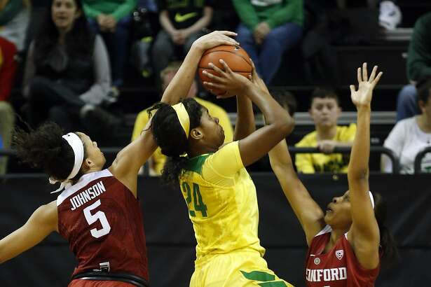 Oregon's Ruthy Hebard has her shot blocked by Stanford's Kaylee Johnson as Stanford's Erica McCall helps defend on the play during the first half of an NCAA college basketball game in Eugene, Ore., Sunday, Feb. 26, 2016. Eighth-ranked Stanford won game 65-59. (Andy Nelson/The Register-Guard via AP)