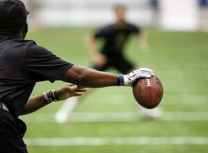 A player reacts to the movement of the ball during drills at the NFL football regional combine at the New Orleans Saints training facility in Metairie, La., Sunday, March 13, 2016. (AP Photo/Scott Threlkeld)
