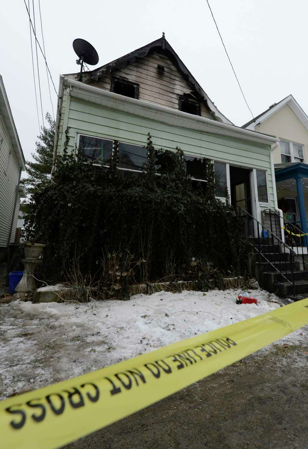 12 Arcadia Avenue Jan. 28, 2013 after a fire struck the home the previous morning in Albany, N.Y. A body was found in the building after the fire was put out prompting the police presence. (Skip Dickstein/Times Union)